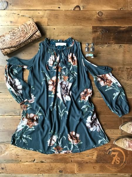 The Indianola - Dusty teal floral dress. Cold shoulder. Gathered neckline with tie. Light ruffle detail around cold shoulder. Front keyhole detail. Gathered cuff. Lined.