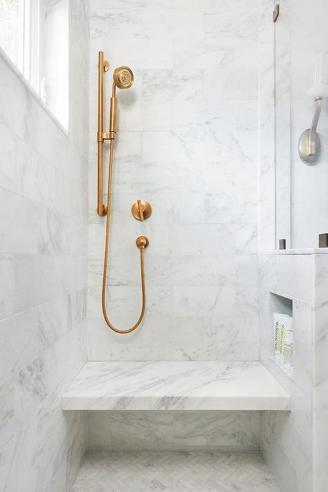 Clover Master shower, large format white and gray marble but with silver hardware. Frameless glass shower wall. Would put a wood tile herringbone pattern floor for rest of the bathroom.