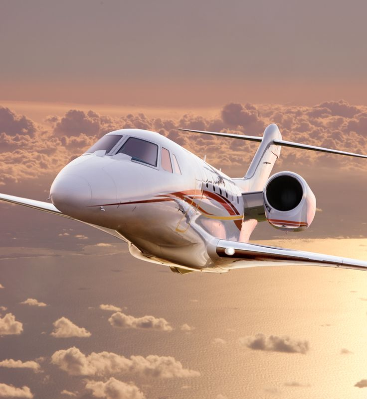 Cessna Citation X aerial shot. tags: aircraft, business jet, photography, commercial aviation, clouds, business traveler, speed, comfort, lifestyles
