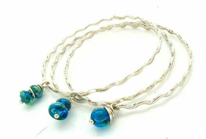 Silver wavy bangles with glass beads