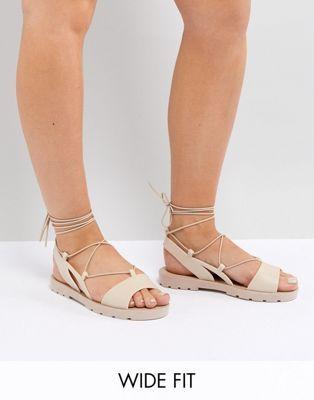 1b7636bc846c ASOS FIZZLE Wide Fit Jelly Tie Leg Sandals