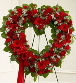 Always Remember Red Floral Heart Tribute The passing of someone we love deeply requires a special tribute. This open heart standing arrangement of fresh red blooms is designed to help your express all