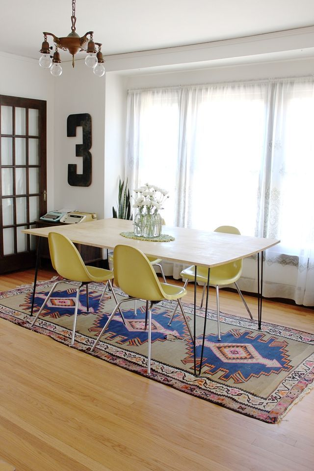 dining room table with colored chairs