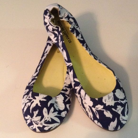 Cute floral pattern blue and white flats Blue and white floral with neon green inside. Never been worn. Great for spring! Mossimo Supply Co Shoes Flats & Loafers