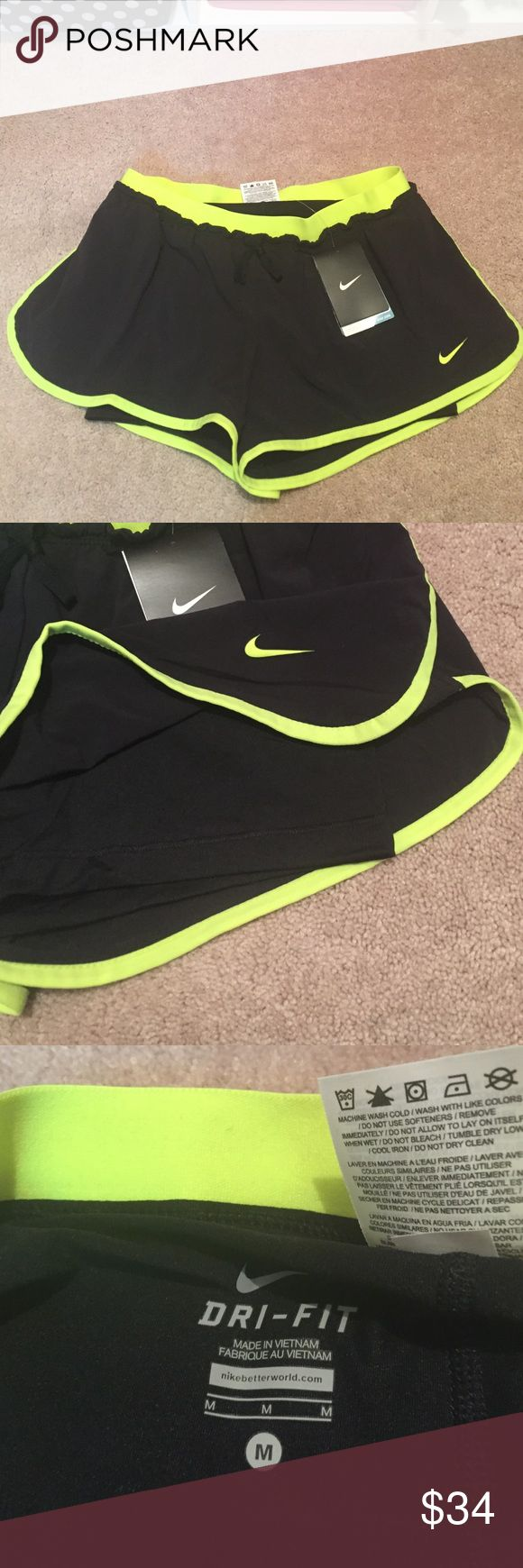 NWT size medium Nike dri-fit shorts New with tags size medium Nike dri-fit shorts. Shorts and black and a neon yellow/green and have attached spandex shorts on the inside Nike Shorts