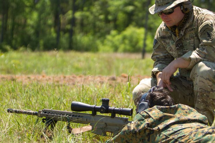 https://flic.kr/p/ssw1AC | 150421-A-KD443-107 | A U.S. Army National Guard Special Forces soldier oversees a Chilean SF soldier engage practice targets during a bilateral training exchange April 21, 2015, at Camp Shelby, Miss. Members of Special Operations Command South organized a monthlong exchange to build strong and enduring partnerships with partner nation forces. (U.S. Army photo by Staff Sgt. Osvaldo Equite/Released)