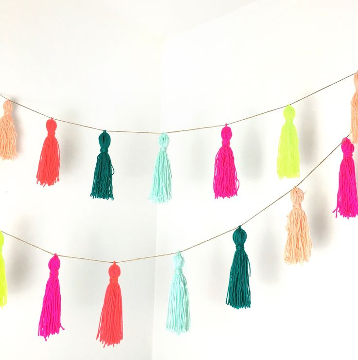 DIY Yarn Tassel Garland for Bachelorette Party or Bridal Shower Decor {Courtesy of Potter and Bloom}