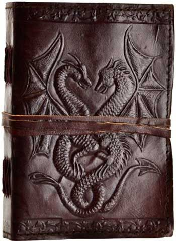 "Hand tooled blank leather journal with embossed double dragons. Border embossing may vary. Sizes vary slightly. Leather, handmade paper. 240 pages, cord closure. 5"" x 7"""