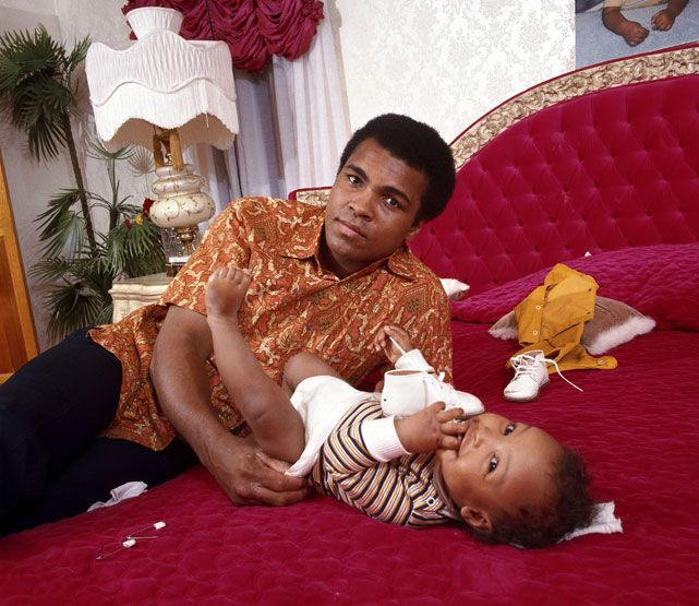 Pictures Muhammad Ali His SON | Muhammad Ali changes the diaper of his son Ibn Muhammad Ali Jr. during ...