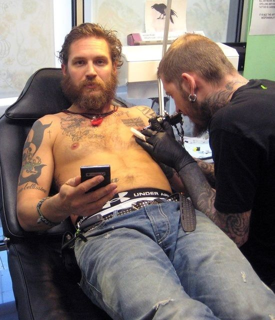 Tom Hardy adding one more tattoo to his body...