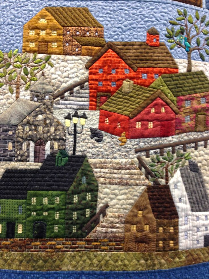 """""""50 Variations of Yoko Saito's Mystery Quilt"""":  an exhibit by Quiltmania at the 20th European Patchwork Meeting in Alsace, France.  Photo byannelize."""