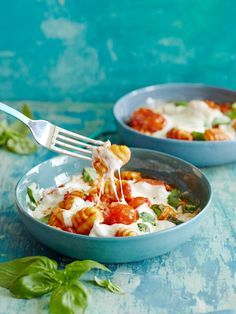 This cheesy baked gnocchi recipe is so good. Adding a little pancetta tomato sauce and plenty of melted fresh mozzarella cheese to top it off!