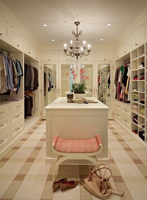 Bright luxury closet with island and chandelier.  #closets #luxuryclosets homechanneltv.com