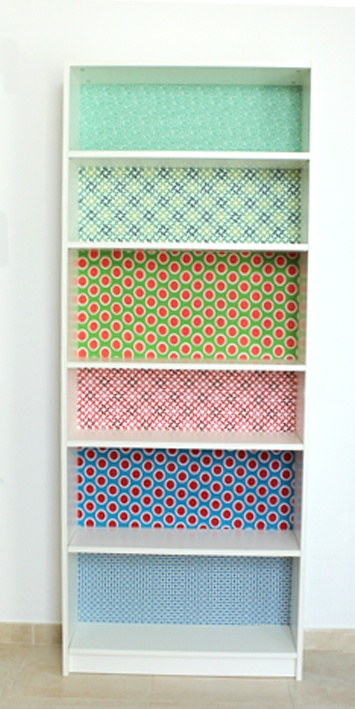 Billy bookcase hack from ikea.. Either paint all one colour or use wall paper in the background