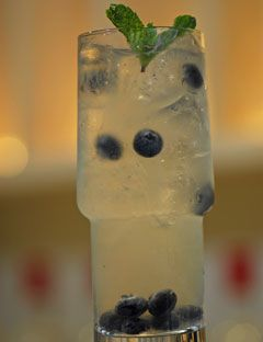 Blue Rain 1 1/3 oz. Sobieski Vodka 1/2 oz. Martini & Rossi Bianco 1 oz. St. Germain Elderflower Liqueur 1/2. oz fresh lime juice  Put all the ingredients in a shaker, shake, and serve in a highball glass. Garnish with 8 blueberries suspended all around the glass.