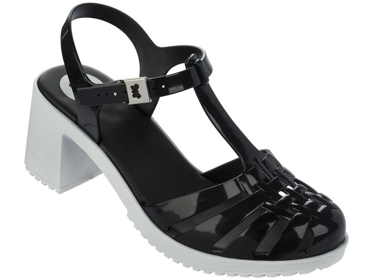 Dream Heel Black Contrast   Be bang on trend this season with the classic jelly shoe revamped with a block heel! With a contrasting white traction sole, and completed with a Zaxy metallic silver butterfly clasp upon the adjustable ankle strap.