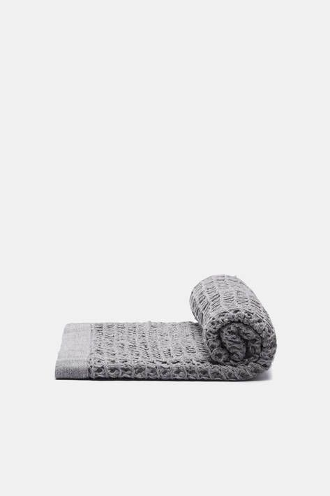 Garment washing gives pure cotton a uniquely soft waffle texture. Woven at gentle speeds on an old-fashioned weaving machine in Imabari, the cotton capital of Japan, this Lattice bath towel from Kontex is extremely absorbent yet lightweight and quick to dry. Durable enough for daily use.