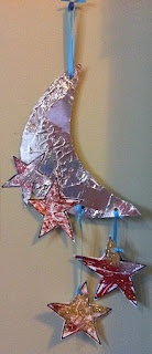 print out both a moon and stars template---have kids wrap moon in aluminum foil---then put glue on stars and have them shake glitter on them. When dry, assemble it and hang from ceiling!