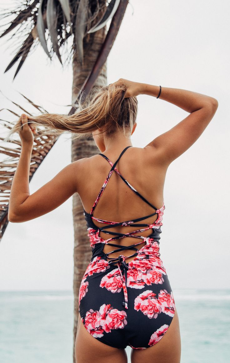 Click to shop! The perfect one-piece swimsuit has arrived. Floral, strappy and high quality fabrics. Say yes to the suit. @albionfit