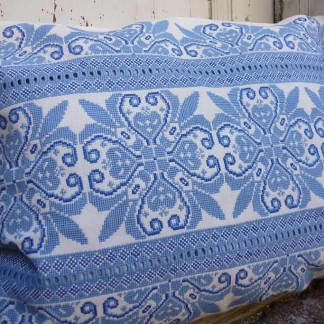 Beautifully hand embroidered in cross stitch with detailed cut work Two shade of blue on an ecru linen base Embrodiered by a master embroiderer