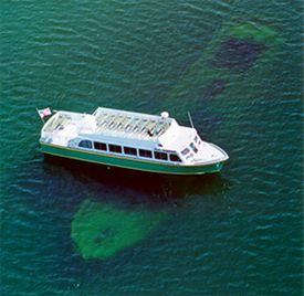 Munising Glass Bottom Boat Tours ......The Bermuda, a 150 foot wooden schooner foundered and sank in the spring of 1870 in Murray Bay on Grand Island. Her top deck is just 12 feet below the water's surface where she has remained.