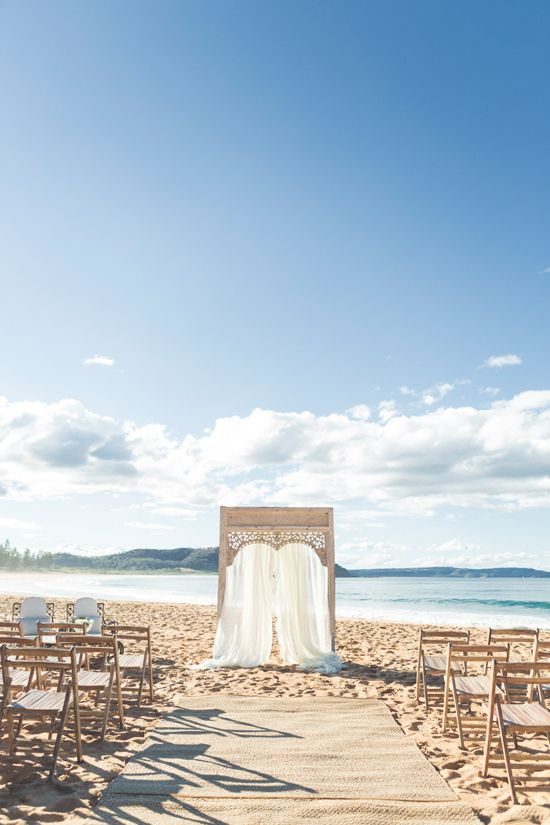 Moroccan styled ceremony structure on the beach. The Romantic Movement Rentals.