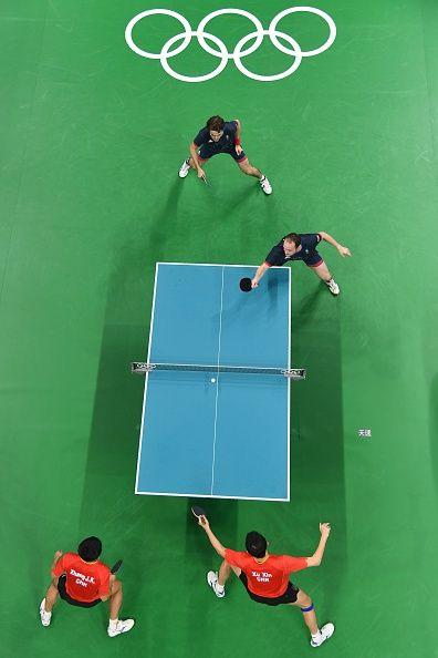 China's Xu Xin and China's Zhang Jike play against Britain's Paul Drinkhall and…