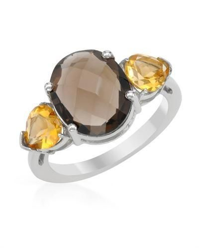 Silver Ring With Topaz - Size 6 Size 6. Charming ring with genuine citrines and topaz beautifully designed in 925 sterling silver. Total item weight 4.1g. Gemstone info: 2 citrines, 1.40ctw., pear shape and yellow color, 1 topaz, 3.58ctw., checkerboard shape and smoky color.