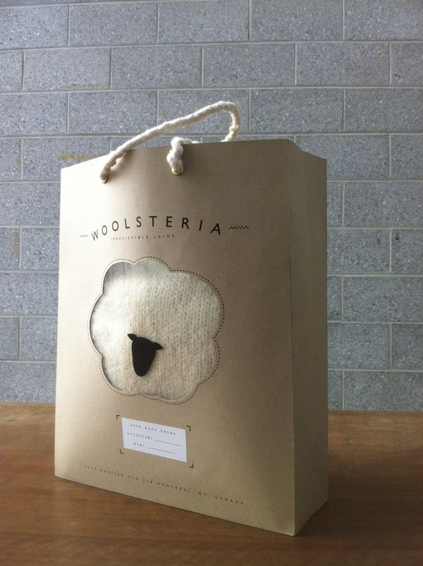 Die-cut window panel has a sheep's head on it so it turns into a sheep with fluffy wool when a sweater is inside. Clever bag cute #packaging PD