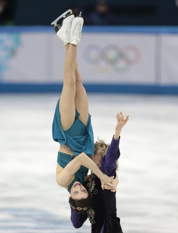 Meryl Davis and Charlie White of the United States compete in the team free ice dance figure skating competition at the Iceberg Skating Palace during the 2014 Winter Olympics, Sunday, Feb. 9, 2014, in Sochi, Russia. (AP Photo/Ivan Sekretarev)