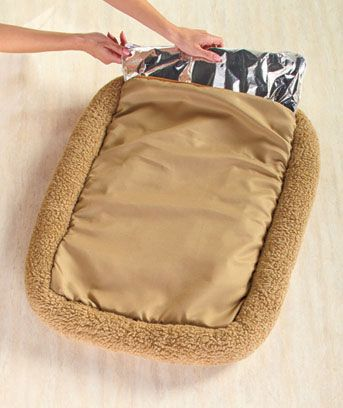 Plush Thermal Self-Heating Pet Beds - put a mylar blanket (found in the camping section of a sporting goods dept) inside bed