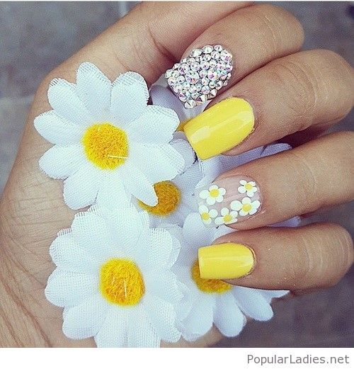 Yellow nails with silver accents