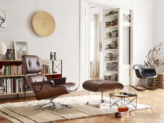 Eames Lounge Chair and Ottoman with the Occasional Table LTR and the Eames Plastic Armchair RAR