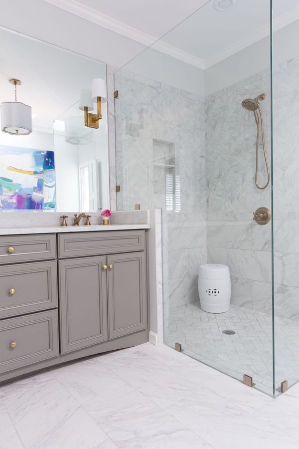 Before & After. A Bathroom Makeover that stayed on budget!  A semi-custom new vanity and creative use of tile gives this bath a fresh look. Porcelain tiles on the floor and throughout the shower are a durable alternative to marble, at a lower price point.