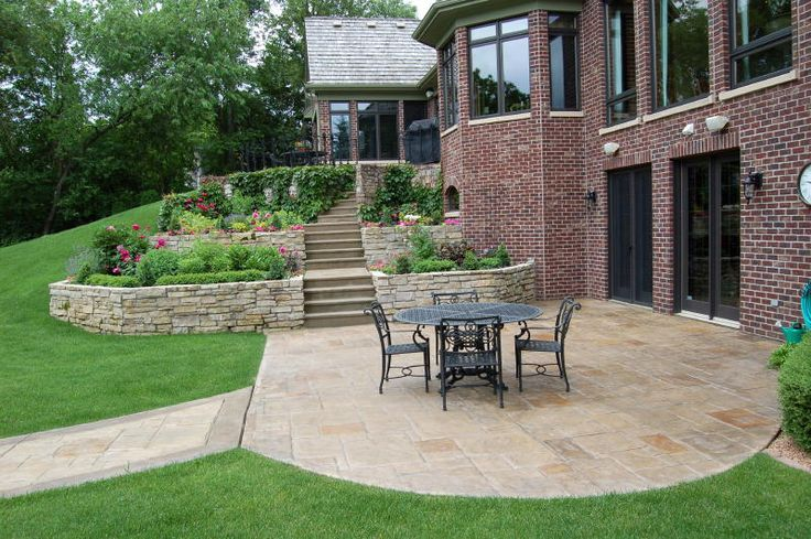 concrete patio and retaining wall designs terraced limestone retaining walls with stamped concrete patio ideas for the house pinterest - Patio Wall Design