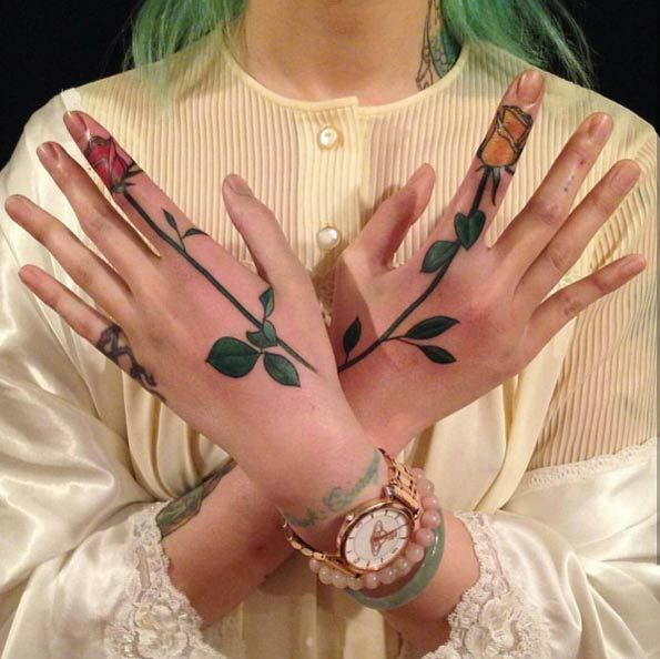 Rose tattoos on hands and fingers by Nalla Smith
