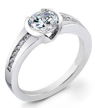 Low set and very comfortable semi-bezel engagement ring for a round center stone.