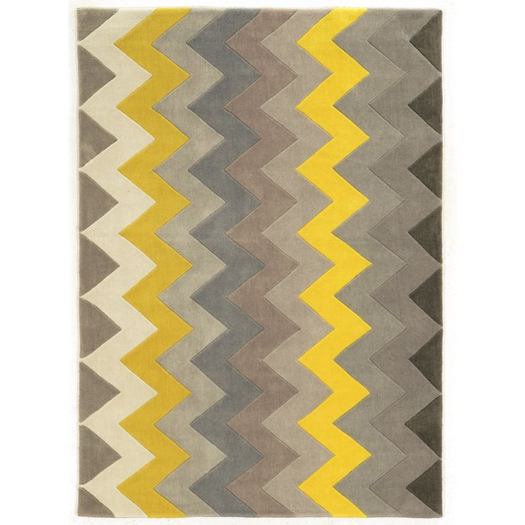 The Linon Trio Collection of area rugs offers transitional styling that blends well with most decor settings. The Chevron rug features a vivid color palette and a plush 0.5-inch pile that is sure to breath new life into any room in your home.
