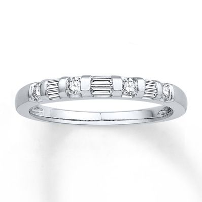 Round and baguette diamonds alternate between lines of 14K white gold to create this eye-catching anniversary band for her. The ring has a total diamond weight of 1/4 carat. Diamond Total Carat Weight may range from .23 - .28 carats.