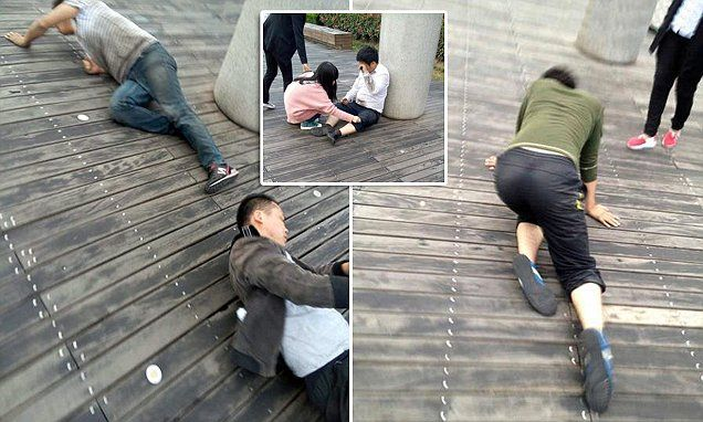 Chinese company staff are forced to crawl in public