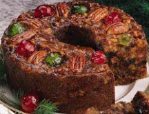 """Fruitcakes are holiday and wedding cakes which have a very heavy fruit content. They require special handling and baking to obtain successful results.    The name """"fruitcake"""" can be traced back only as far as the Middle Ages. It is formed from a combination of the Latin fructus, and French frui or frug."""