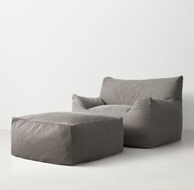 RH TEEN's Berlin Lounge Chair:The next-generation bean bag. Our collection's body-conforming foam-and-bead insert ensures classic sink-in comfort, while the raised back and armrests add an element of support to its relaxed silhouette.