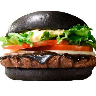 """Burger King locations in Japan will soon introduce a burger that has a """"jet-black bun made from bamboo charcoal [and] a single frightful slice of tarry black cheese,"""" as Clint Rainey put it."""