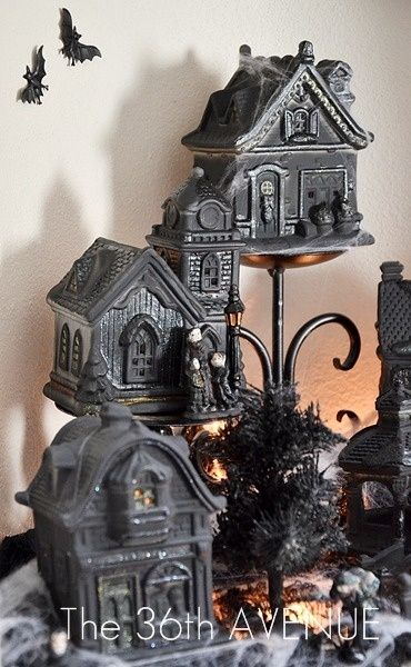 DIY Halloween village made with…spray painted Dollar Store Christmas village buildings,,,,or yard sale finds, chips & imperfections wouldn't matter
