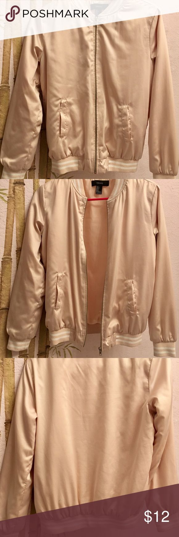 Rose gold Bomber Jacket This Light Pink Bomber Jacket is silky but warm and would be a great addition to any closet! Only imperfection is a small blue mark on the back but this is very unnoticeable when worn. Offers Welcome! Forever 21 Jackets & Coats