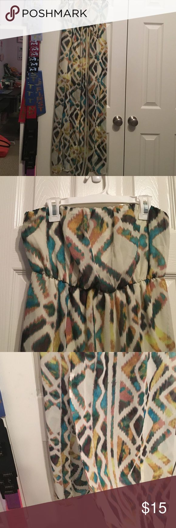 Strapless Aztec Maxi Dress Strapless Aztec Maxi dress with a slit on the right side. It is perfect for beach vacations!! It has been worn less than five times and has no damage or discoloration! Charlotte Russe Dresses Maxi