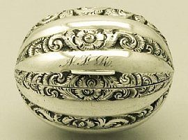 An antique Victorian English sterling silver nutmeg grater in the form of a natural nutmeg/
