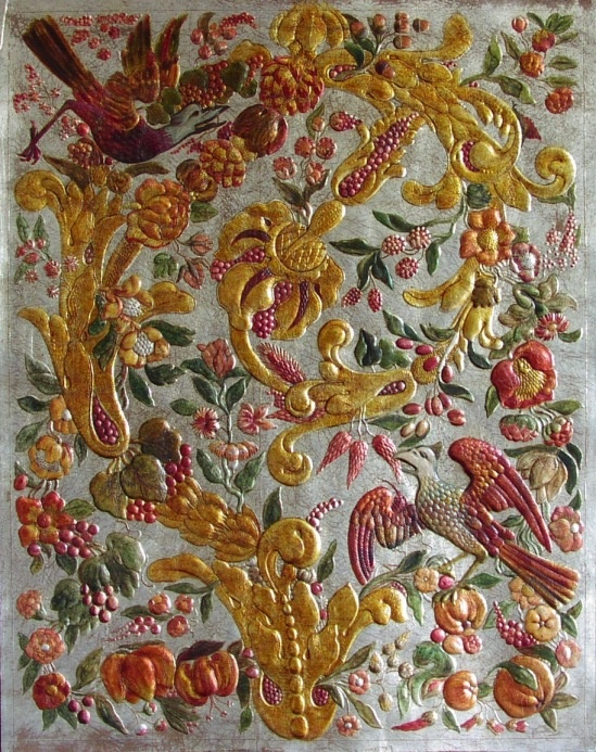 Detail of hand embossed gilded and painted leather from Spain used to upholster Chairs and to make table tops  @Panted furniture