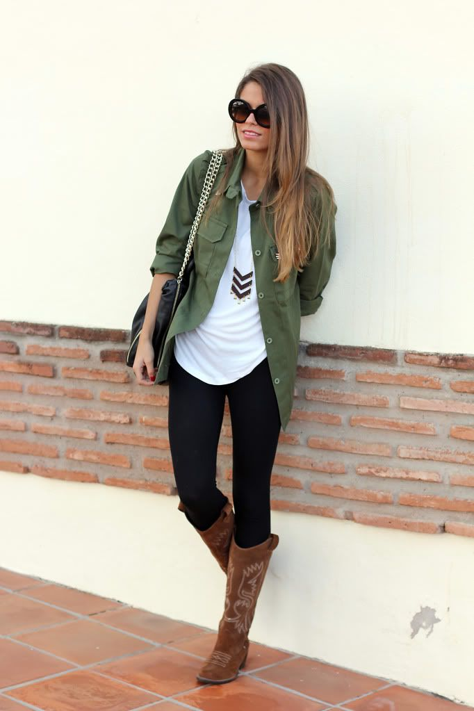 Long dark green dress shirt over some light colored top with black leggings and cowboy decorated boots.