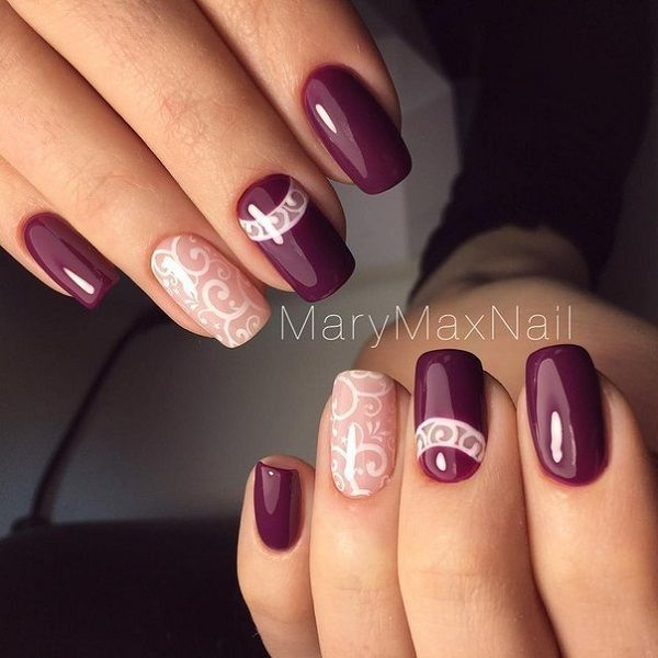Elegant looking white and maroon nail art design. The dark maroon polish is greatly contrasted by the light and white nail polish with lace like designs.